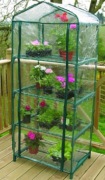 Bring Spring Inside!  :)  4 Tier Mini Greenhouse  I WANT ONE OF THESE!!!!